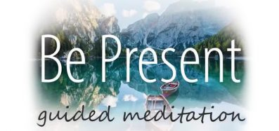 "Text ""Be Present Guided Meditation"" over an image of boats on a calm lake between mountains"