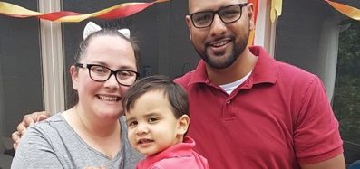 A photo of the Vaithilingham family: Jenny, Darren and their son Elias