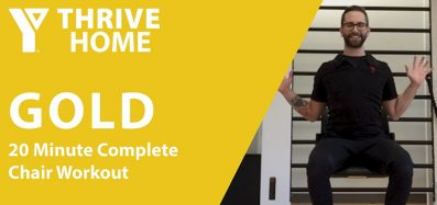 Still image of instructor Colin completing the YThrive GOLD 20 Minute Complete Chair Workout