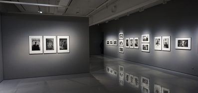 Photo of an art gallery showing several black and white photos on the walls