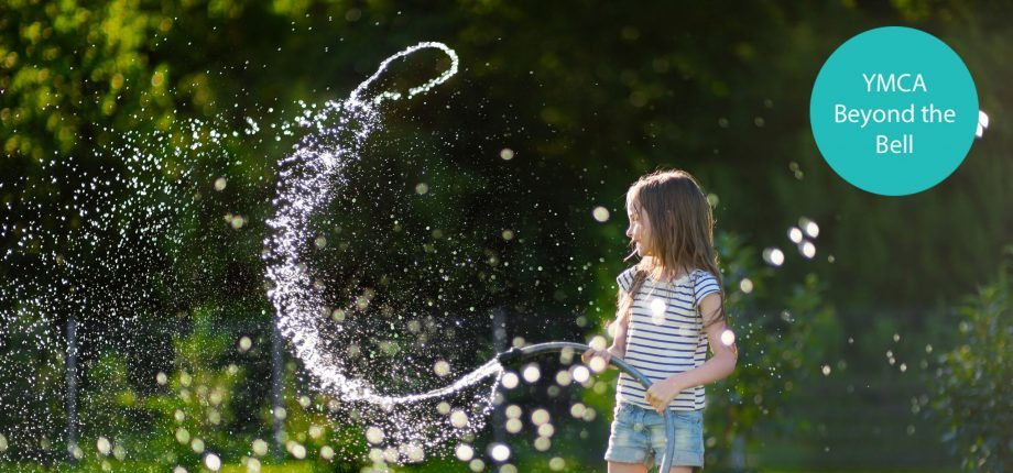 Child playing with water hose